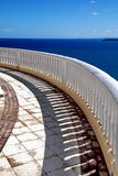 San Juan, Puerto Rico. Curved stone detailed railing across brilliant blue waters of the Caribbean and Atlantic ocean on the coast of Puerto Rico Royalty Free Stock Image