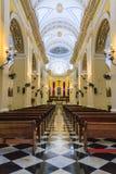Interior of a catholic cathedral in San Juan. San Juan, Puerto Rico - FEBRUARY 28, 2018: Catedral de San Juan Bautista Catholic Church Interior. Vertical photo Stock Image