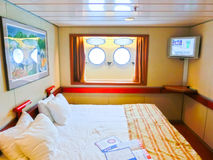 San Juan, Puerto Rico - May 08, 2016: inside cabin with two portholes at The Carnival Cruise Ship Fascination. San Juan, Puerto Rico - May 08, 2016: The inside Royalty Free Stock Photos