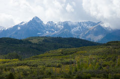 San Juan Range. Afternoon storm gathers over the peaks of the San Juan Mountains in early fall Stock Image