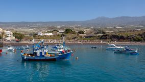 SAN JUAN, TENERIFE/SPAIN - FEBRUARY 22 : View of San Juan Harbour in Tenerife on February 22, 2011. Unidentified people royalty free stock image