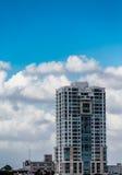 San Juan Tower Under Partly Cloudy Skies. A modern office tower rising over San Juan, Puerto Rico royalty free stock photos