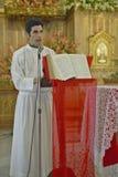 San Lazaro Catholic Church and priest in El Rincon, Cuba Stock Image