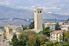 San Leo. A small beautiful medieval village in central Italy and its Romanesque tower royalty free stock photos