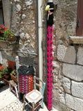 San Lorenzello - Rainwater and crochet basket. San Lorenzello, Benevento, Campania, Italy - June 1, 2018: Wool crochet tights that embellish waste bins and royalty free stock photography