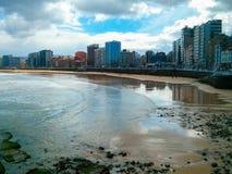 San Lorenzo beach in Gijon, Asturias, Spain. Awesome beach through long avenue with buildings royalty free stock images