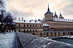 San Lorenzo de el Escorial Monastery on a stormy day. The south face under a snow layer Stock Image