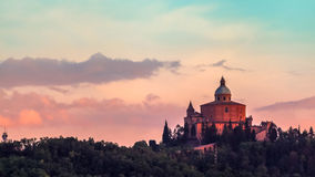 San Luca Church twilight. San Luca basilica church on Bologna hill, in a colorful twilight. orange and blue. in Italy Royalty Free Stock Photo