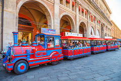 San Luca Espress. Bologna, Italy - May 28, 2016: Tourist train at side of Palazzo dei Banchi in Piazza Maggiore. San Luca Espress is the tourist line which royalty free stock photography