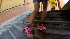 San Luca Sanctuary run. Bologna, Italy - September 29, 2018: running woman under stairway of the San Luca archway, longest porch in the world leading to overhead stock footage