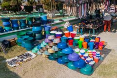 SAN MANUEL DE COLOHETE, HONDURAS - APRIL 15, 2016: Household articles for sale at a market stall. There is a big market. In this village twice a month stock photo