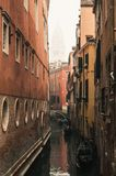 San Marco bell tower seen from an alley in Venice on a foggy day stock photos