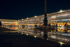 San Marco night reflection. The famous Piazza San Marco in Venice, Italy in the night, reflected in the `Acqua Alta` water that is slowly flooding the place Royalty Free Stock Photos