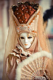 San Marco square. Beautiful venetian masked model from the Venice Carnival 2015 Stock Photos