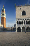San Marco square with campanile and doge`s palace at sunrise in Venice, Italy Royalty Free Stock Images