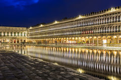 San Marco square with reflection on water at night, Venice Stock Photos