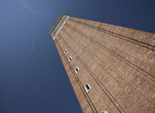 San Marco Square, Venice, Italy/the Bell Tower. This image shows the Bell Tower on the San Marco Square in Venice, Italy. It was taken looking up against a blue Stock Image