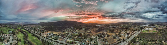 San Marcos sunset. Sunset in San Marcos, California. This is a 5 image aerial panoramic. San Marcos is in North county San Diego stock image