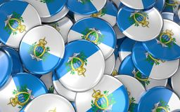 San Marino Badges Background - Stapel van sammarinese Vlagknopen Stock Foto