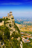 San Marino castle. Beautiful castle lying atop of a mountain royalty free stock images