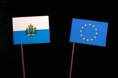 San Marino flag with European Union EU flag  on black Royalty Free Stock Photography