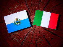 San Marino flag with Italian flag on a tree stump isolated Royalty Free Stock Photography