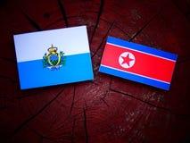San Marino flaga z koreańczyk z korei północnej flaga na drzewnym fiszorku Fotografia Stock
