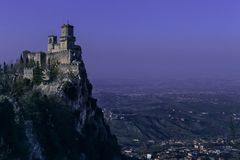 San Marino fortress landscape at dusk. Purple night sky Royalty Free Stock Images