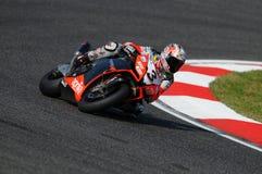 San Marino, Italia - 26 settembre 2009: Fabbrica di Aprilia RSV4 del gruppo di corsa di Aprilia, guidata da Max Biaggi Immagini Stock Libere da Diritti