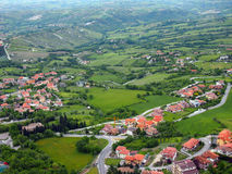 San Marino - a panoramic view from a great height. San Marino - a panoramic view of the typical landscape of small mountainous country royalty free stock photos