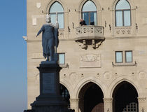San Marino. View to the Palazzo Pubblicco and statue of Freedom at sunny day Stock Images
