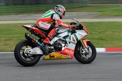 San Marino, Włochy - Sept 24, 2010: Aprilia RSV4 fabryka Aprilia Bieżna drużyna, jadąca Max Biaggi Fotografia Royalty Free