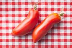 San marzano tomatoes. San marzano tomatoes on checkered tablecloth Stock Photo