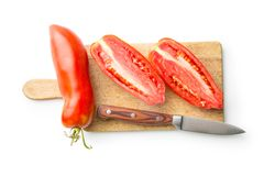 San marzano tomatoes. Halved San marzano tomatoes isolated on white background. Top view Stock Photos