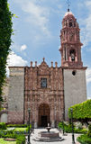 San Miguel Allende Cathedral Facade. The adorned facade of the single tower Cathedral of San Miguel Allende and its geometric garden Royalty Free Stock Images
