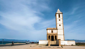 San Miguel Beach and Salinas church, take in Cabo de gata, Almeria, Spain. Almeria, SPAIN - May 21: San Miguel Beach and Salinas church, take in Cabo de gata stock photo