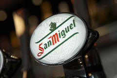 SAN MIGUEL BEER PUMP IN BAR Stock Photo