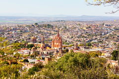 San Miguel de Allende. San Miguel de Allende, a colonial city in Mexico central highlands, is known for its baroque Spanish architecture, thriving scene and stock images