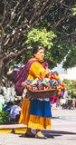 Mexican woman with traditional dress selling handcrafts royalty free stock image