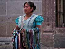Indigenous native-american woman selling hand-crafted jewelry in the streets of San Miguel de Allende. San Miguel de Allende, Guanajuato / Mexico - September 17 Royalty Free Stock Photos