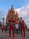 San Miguel de Allende, Guanajuato / Mexico - September 14 2015: Mariachis performing in the street outside of la Parroquia de San stock photography