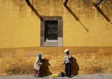 San Miguel De Allende, Mexico-January 18, 2017: People walk past a buildling Stock Photography