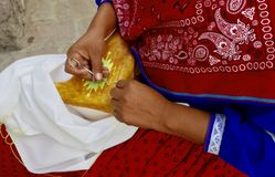 San Miguel De Allende, Mexico-January 16, 2017: A woman creates traditional beeswax and thread art Stock Photos