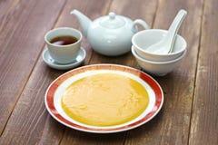San-nian bu, Chinees die niet de pudding van de eierdooiervla plakken stock fotografie