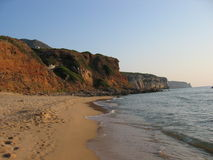 San Nicolo beach. Scenic view of San Nicolo beach with cliffs in background, Sardinia, Itay stock photography
