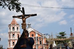 Huge crucifix carried by holy man, street drama, community celebrates Good Friday representing the events that led to the Crucifix. San Pablo City, Laguna royalty free stock images