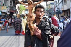 Huge crucifix carried by holy man, street drama, community celebrates Good Friday representing the events that led to the Crucifix. San Pablo City, Laguna stock photo
