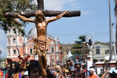 Huge crucifix carried by holy man, street drama, community celebrates Good Friday representing the events that led to the Crucifix. San Pablo City, Laguna royalty free stock photo