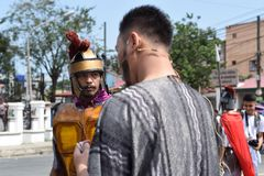 Judas iscariot confronted by rude roman soldier, street drama, community celebrates Good Friday representing the events that led t. San Pablo City, Laguna stock image