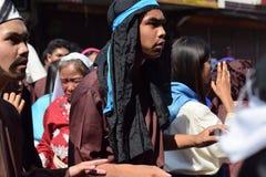 Mob of furious people persecuting Jesus Christ gaher on plaza cheering, ridicule, street drama, community celebrates Good Friday r. San Pablo City, Laguna stock photos